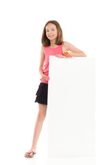 Smiling girl presenting blank banner