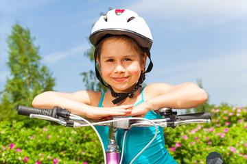 Cute little girl with a bike