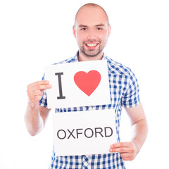 Man with city sign Oxford.