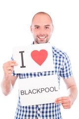 Man with city sign Blackpool.