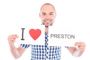 Man with city sign Preston.