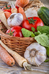 local organically grown vegetables on a wooden background
