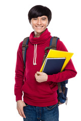 Asian student with backpack and handbook