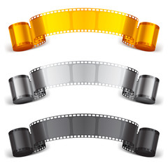 Three scrolls of color movie tapes.