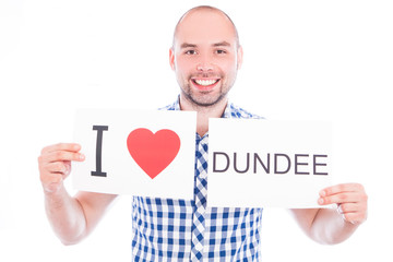 Man with city sign Dundee.