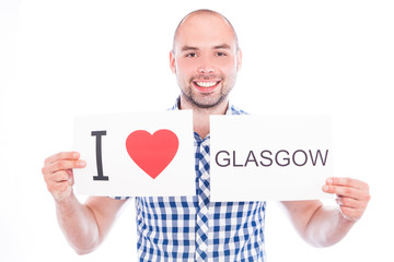 Man with city sign Glasgow.