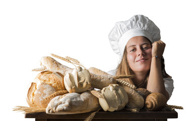 young woman dressed as a baker near a table with bread