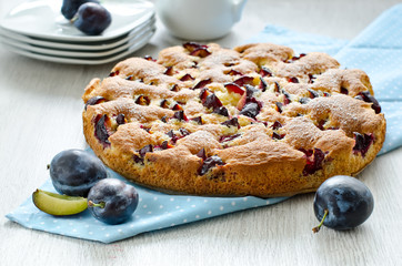 Baked cake with plums ready to eat