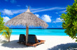 Beach chairs on tropical beach - 68364645