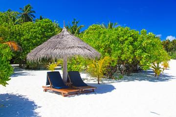 Beach chairs on tropical beach