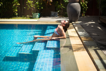Girl relaxing in the swimming pool