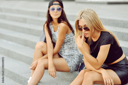 canvas print picture Two young women on a street