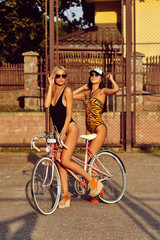 Cool young model girls with vintage bicycle