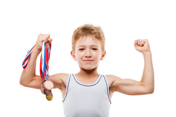 Smiling athlete champion child boy gesturing for victory triumph