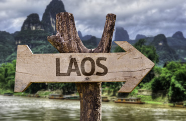 Vang Vieng wooden sign with a forest background