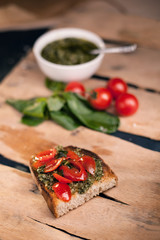 Bruschetta with cherry tomato and herb pesto