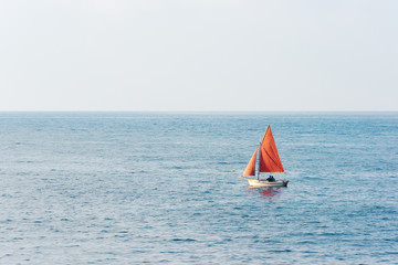 small sailboat on water