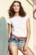 beautiful brown-haired woman in denim shorts