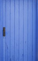 Blue shed door with locker