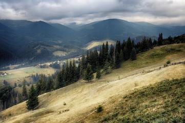 Carpathian mountain hills at cloudy sunrise