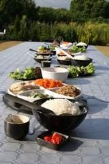 Korean food on table in garden