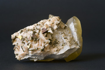 Chalcopyrite on dolomite with large calcite crystal. 10cm across