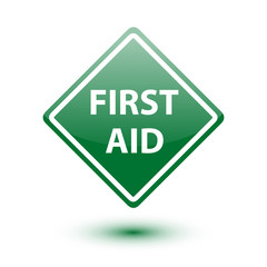 First aid green sign on white