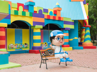 Colorful toy town building with coloful blocks and a boy cartoon