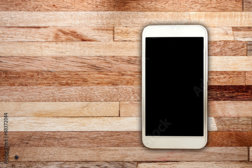 White smart on wooden desk - 68372044