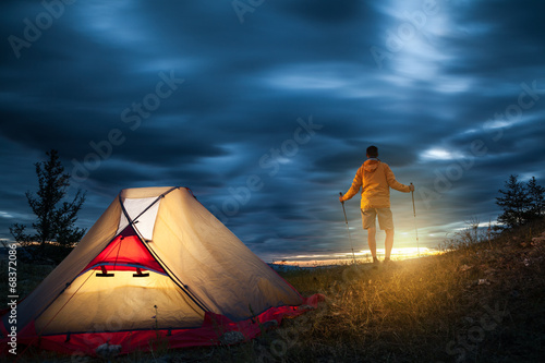 Man on camping at sunrise
