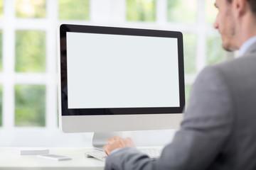 Businessman front of desktop