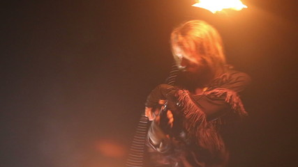 bearded man in fire performance