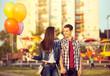 Happy couple in the amusement park