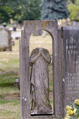 Gravestone statue missing head