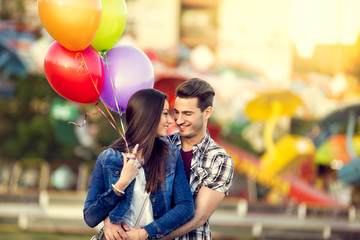 Romantic couple with balloons