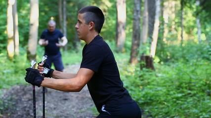 Teenager exercising with walking sticks episode 2