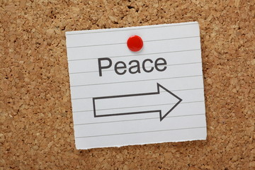 Peace This Way reminder on a cork notice board