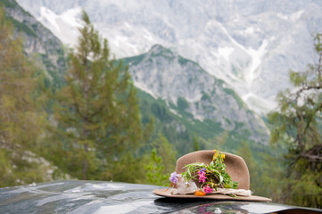 hiking hat with flowers on a tin roof