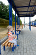 little girl at the bus station
