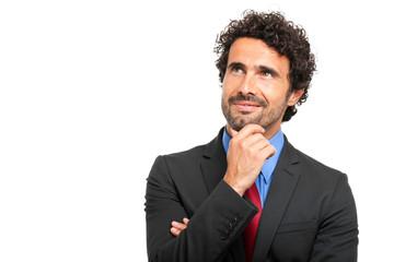 Thoughtful businessman isolated on white