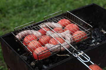 Cooking sausages with tomatoes
