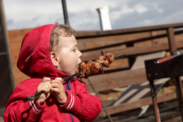 Kid eating a kebab