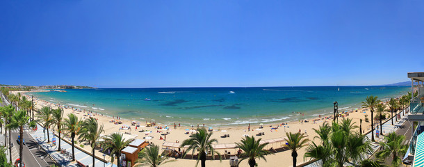 Beautiful beach in Spain with bright blue sea