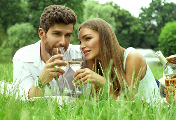Handsome couple drinking white wine on date