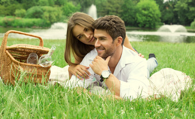 Attractive young couple on picnic