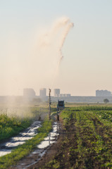 watering machine on agricultural field in summer