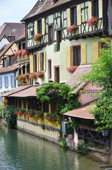 Colmar, Petit Venice, water canal and traditional colorful house