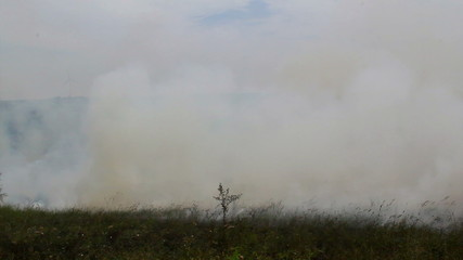 Controlled burning of a field in preparation for autumn planting