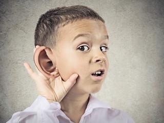 Nosy little man listening carefully to someone's secrets