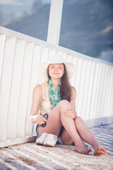 Portrait of young happy beautiful girl outdoors in sunny summer